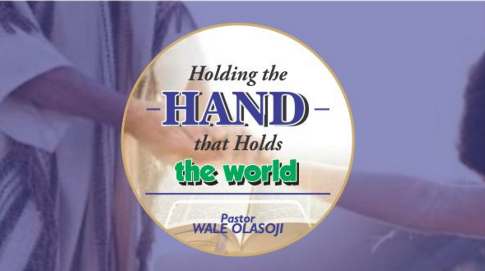 Holding the HAND that holds the world Image